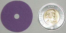 Mini Disc compared to a Toonie