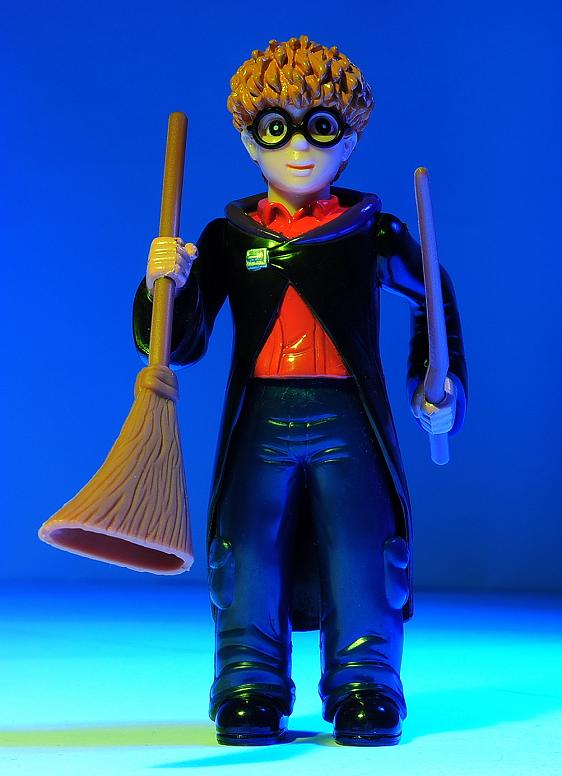 Knock Off Harry Potter Holding the Broom and Wand